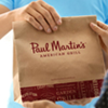 Promotional image for NEW Family Meals To-Go from Paul Martin's American Grill